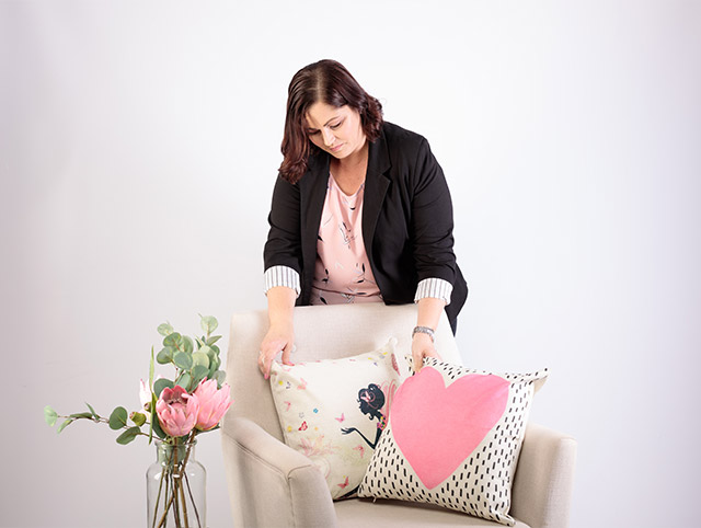Sally styling a chair for a branding shoot